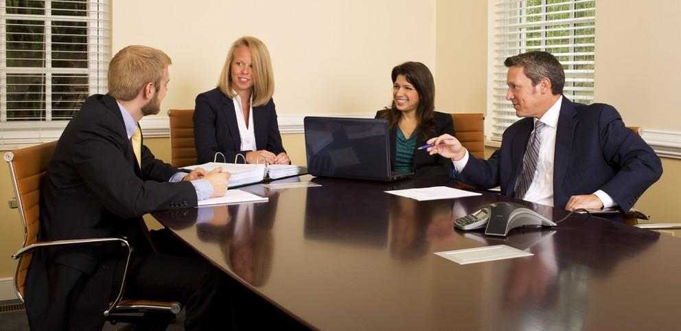 Lawyers at GreeneHurlocker discussing a client matter